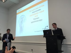 two people presenting at a lectern
