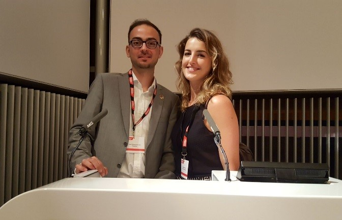Marlene and Ilias standing at a lectern