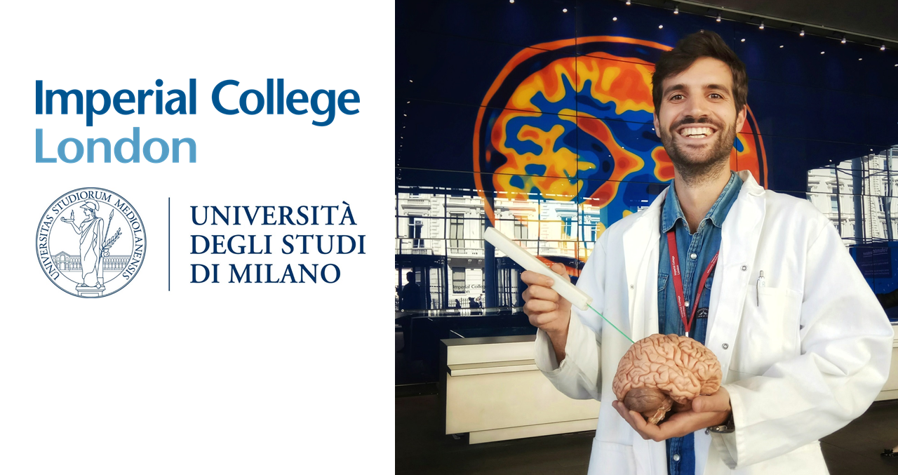 man smiling with a model brain and EDEN catheter