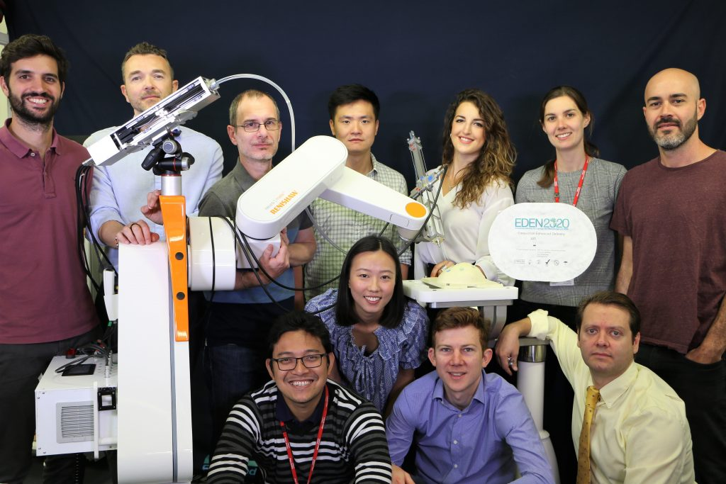 The EDEN team standing with the EDEN robotic system