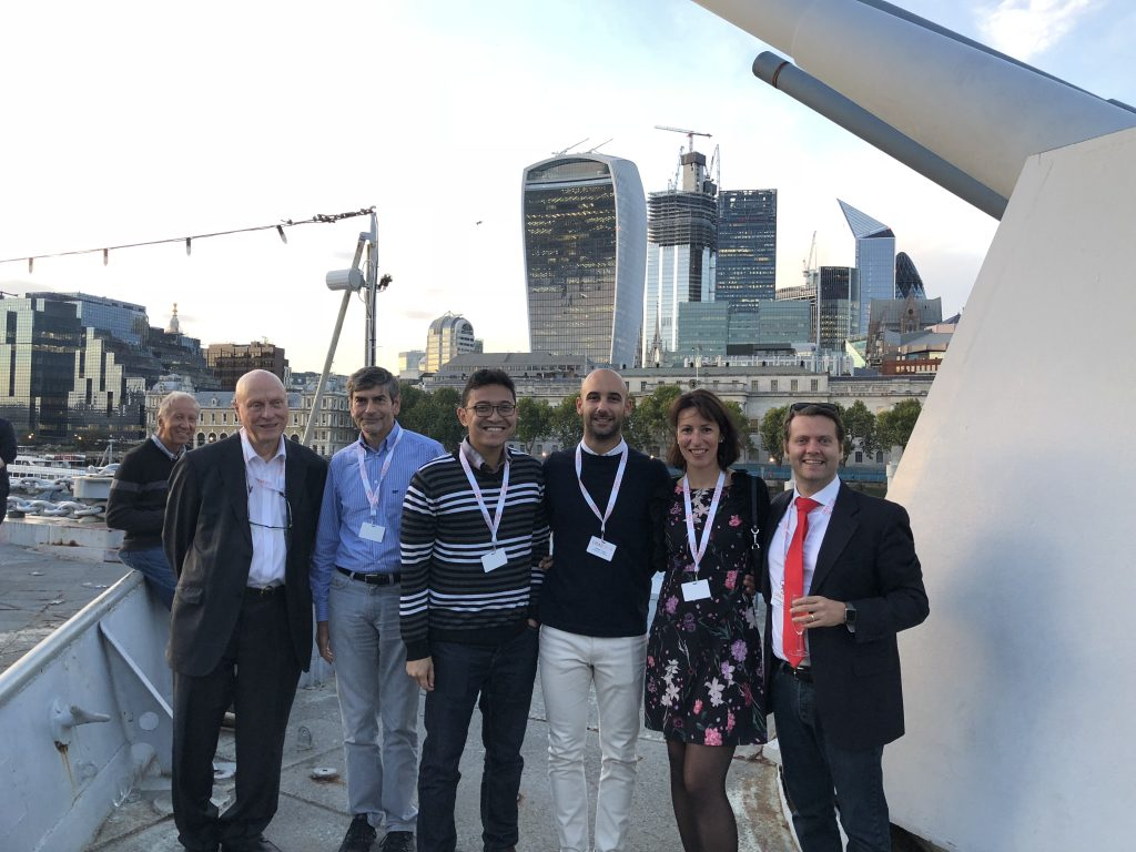 The EDEN team standing in front of a London city landscape