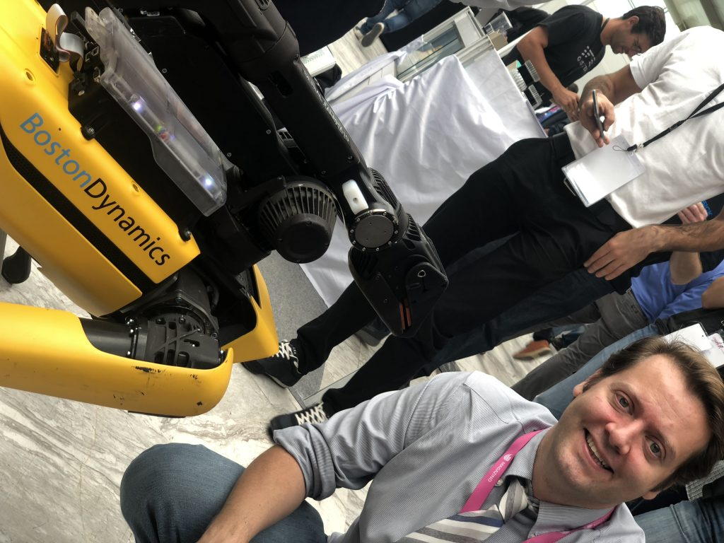 Ferdinando smiling with the Boston Dynamic robot