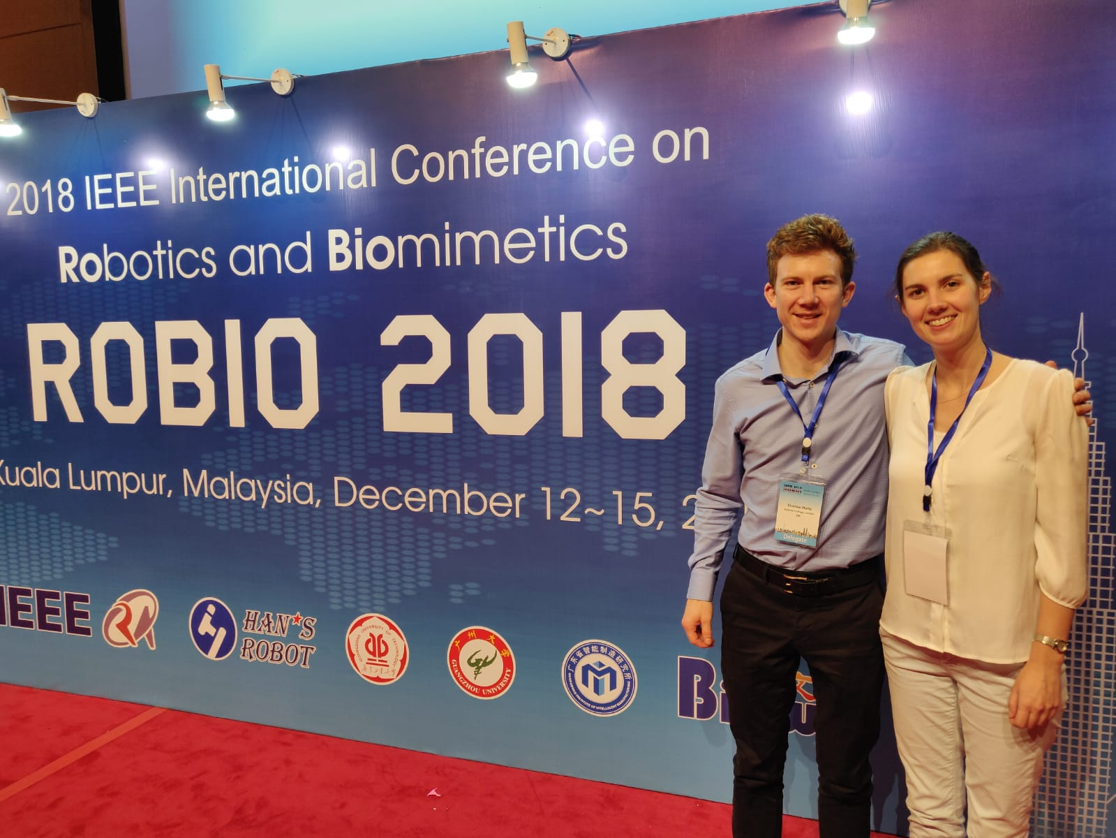 tom and eloise in front of ROBIO 2018 banner