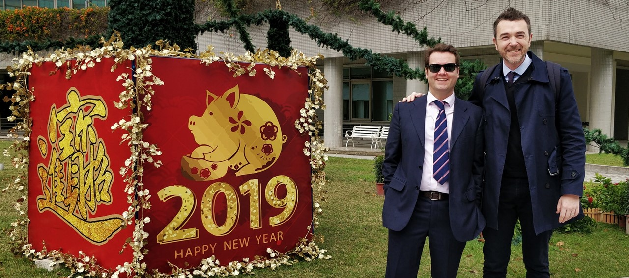 Ferdinando and Riccardo standing in front of a 2019 happy new year sign