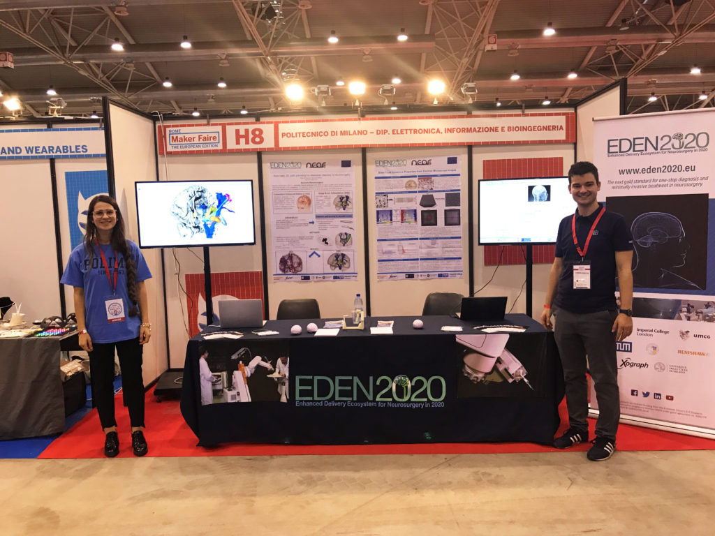 Alice Segato and Marco Vidotto standing next to the EDEN2020 science station at Maker Faire Rome