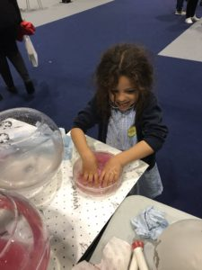 Kids feeling the gel-brain model at the EDEN2020 pop-up science station at New Scientist Live 2019